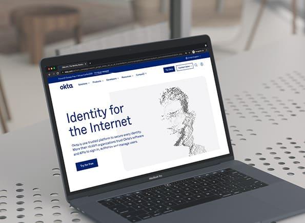 Okta website on a laptop screen